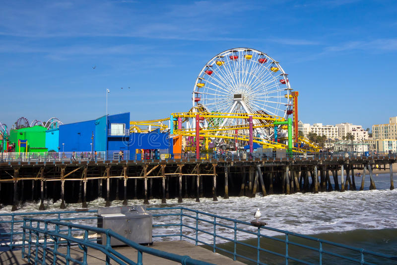 Santa Monica Pier. Image of the popular destination; the pier at Santa Monica, California, with views of the ferris wheel and roller coaster royalty free stock photos