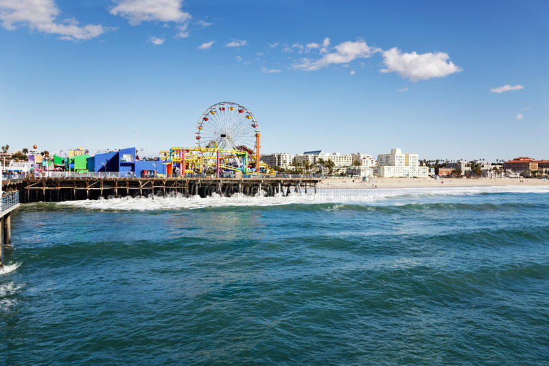 Santa Monica pier. Amusement park on Santa Monica pier with the beach in the background royalty free stock photo