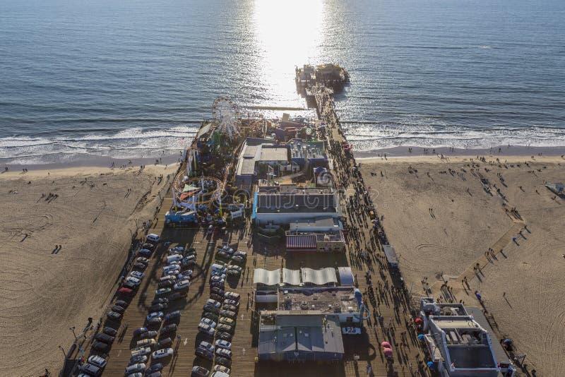 Santa Monica Pier and Pacific Ocean Aerial. Santa Monica, California, USA - December 17, 2016: Late afternoon aerial of Santa Monica Pier and the Pacific Ocean royalty free stock photos