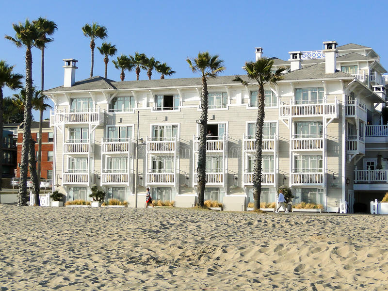 Santa Monica, USA, June 14 2011: big white house on the beach in. Santa Monica. People take a walk and go footing stock photo