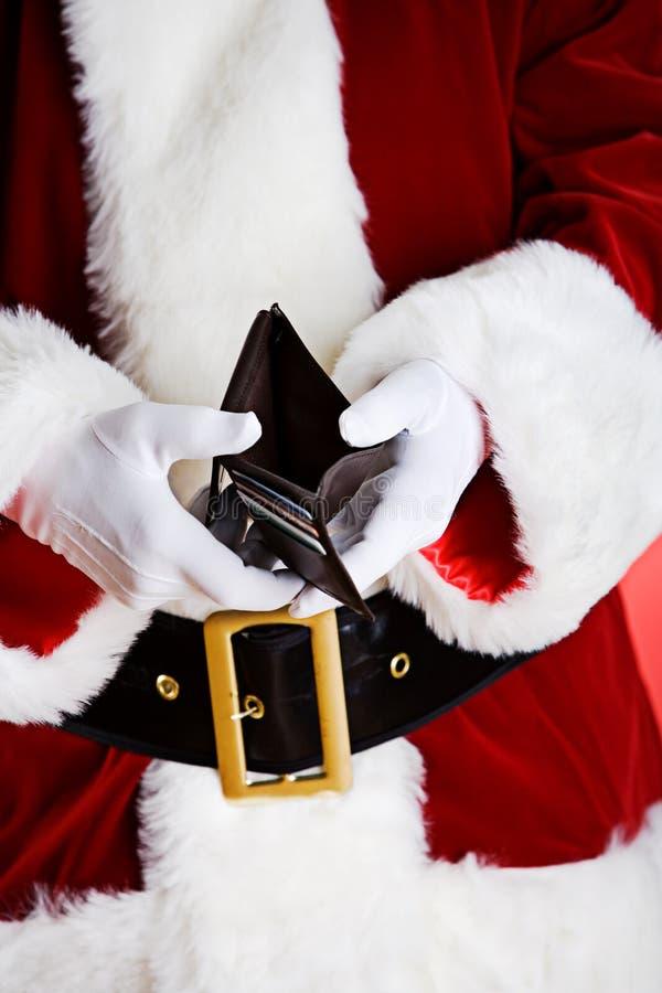 Santa: Mostrando a carteira vazia imagens de stock