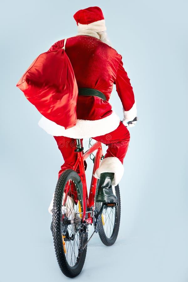 Santa na bicicleta imagens de stock royalty free