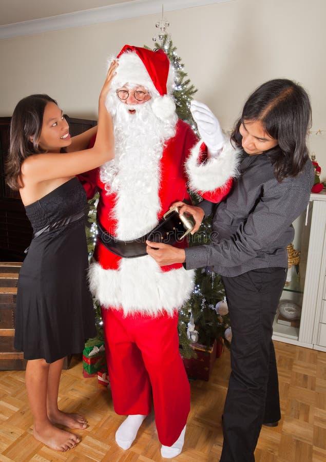 Santa obtenant rectifiée photo stock