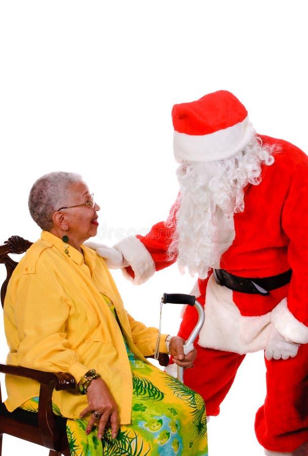 Santa och pensionär arkivbild