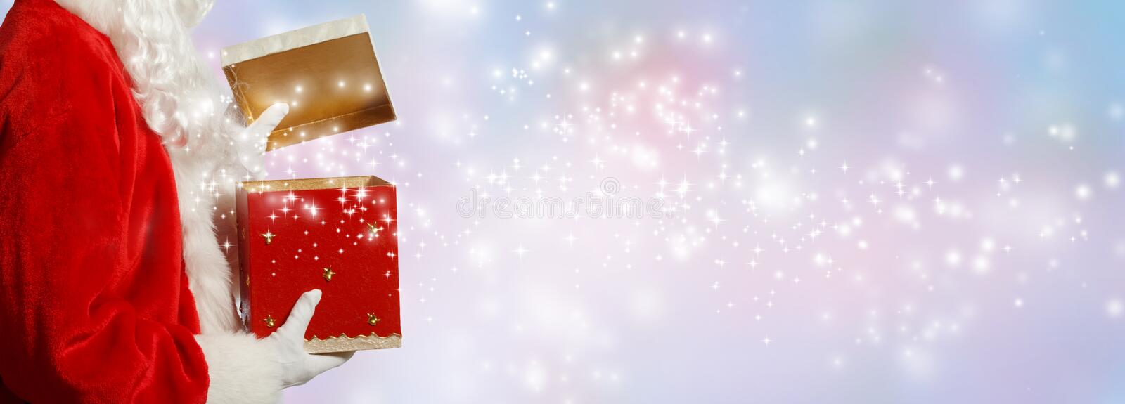 Santa opening a gift box royalty free stock images