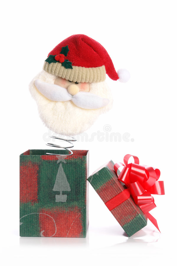 Santa out of box. Santa Claus head on spring popping out of xmas box over white background stock photo