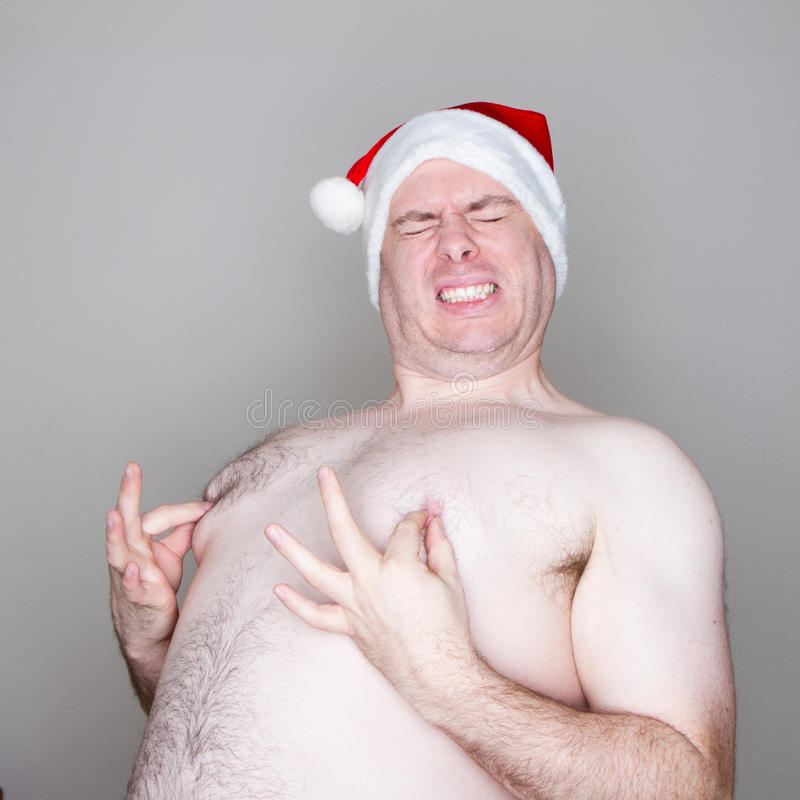 Download Santa pinching his nipples stock photo. Image of large - 51898868