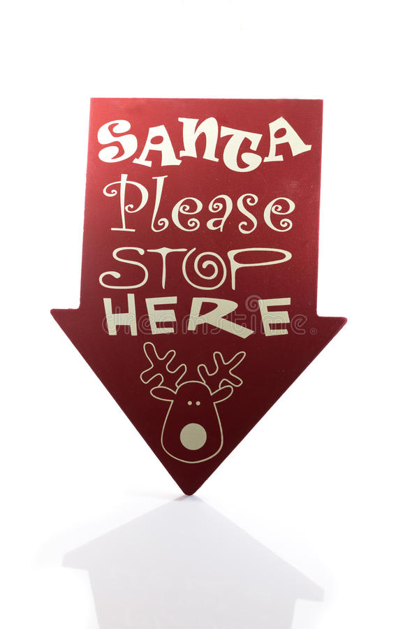 Santa please stop here sign casting a reflection stock photography