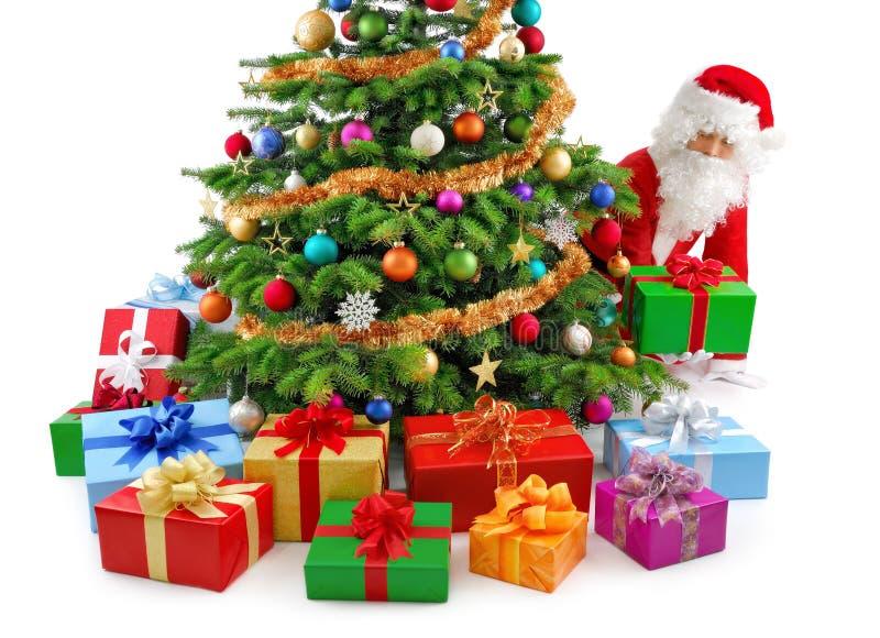 Santa préparant les cadeaux photographie stock