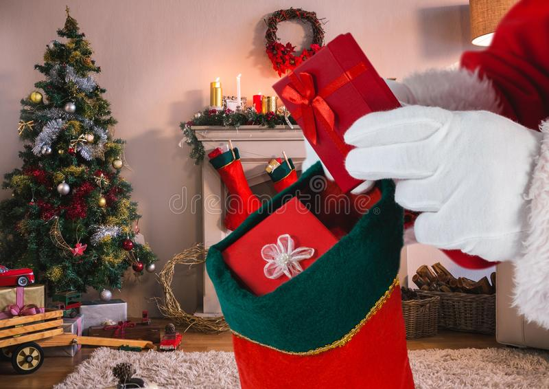 Santa putting gifts in christmas stocking in living room. At home vector illustration