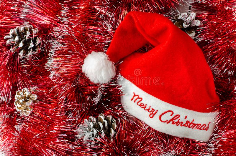 Santa red hat. Christmas composition. Postcard or greeting card stock image