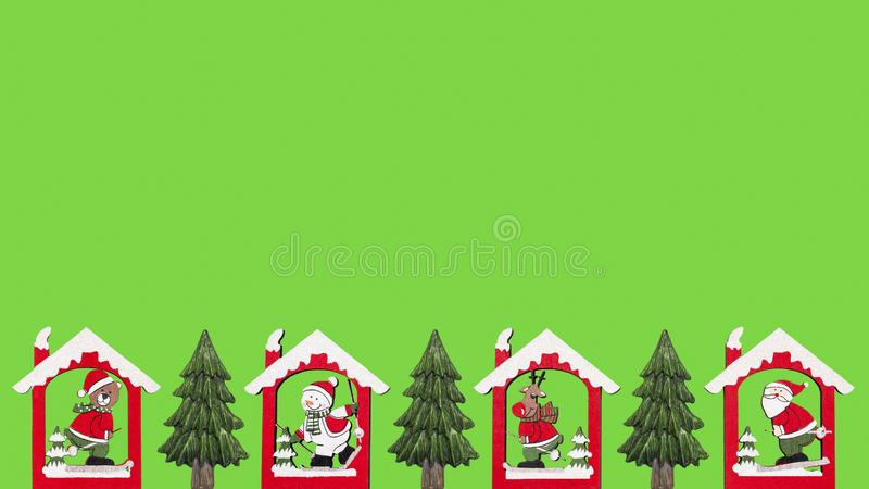Santa, reindeer, snowman and bear in the house with fir trees royalty free stock image