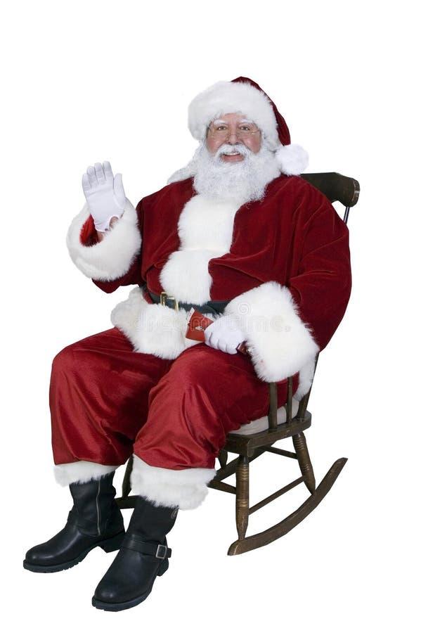 Santa Rocking royalty free stock photography
