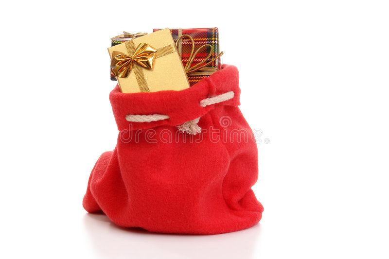 Santa's bag. Santa Claus bag full of christmas presents over white background stock image