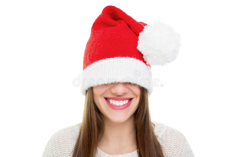 Santa's beanie hat is too big. Beautiful happy young Caucasian brunette woman wearing Santa Claus beanie hat that is too big for her. Christmas and teeth care stock images