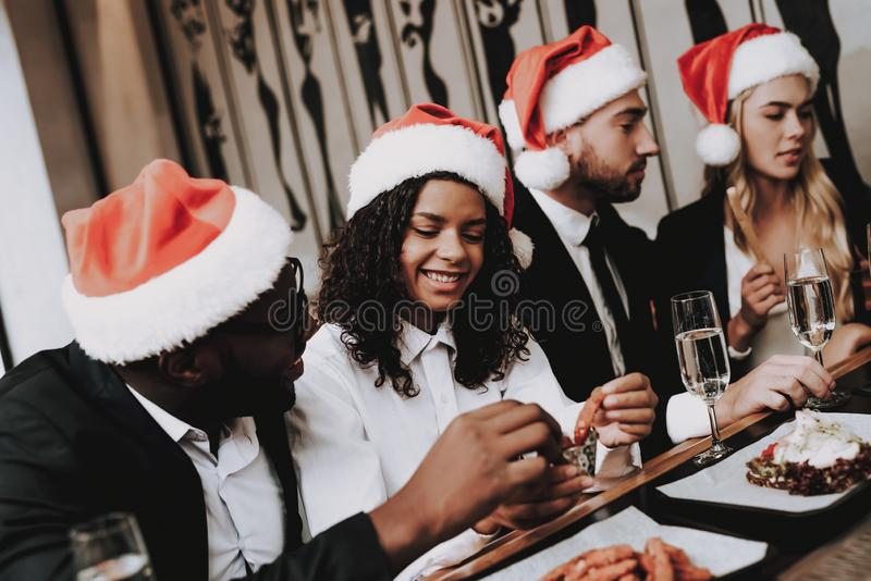 Santa`s Hat. Different Races Communicate. Rest. royalty free stock images