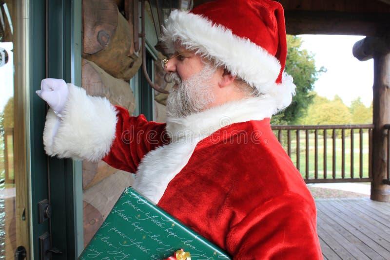 Santa S Knocking Royalty Free Stock Photography
