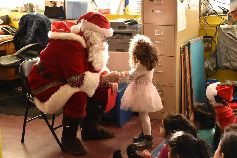 Santa`s Magical Moment. A child`s first experience with Santa Claus. a perfect balance of Awe and wonder stock photos