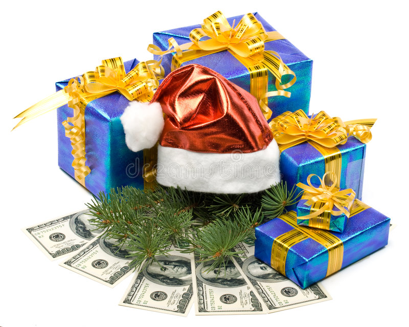 Santa's red hat, gift boxes and money. On a white background royalty free stock photos
