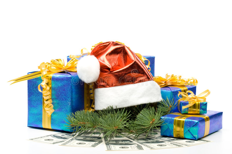 Santa's red hat, gift boxes and money. On a white background royalty free stock photography