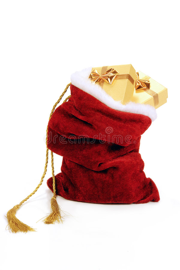Santa's sack. Santa Claus bag full of christmas presents over white background royalty free stock photo