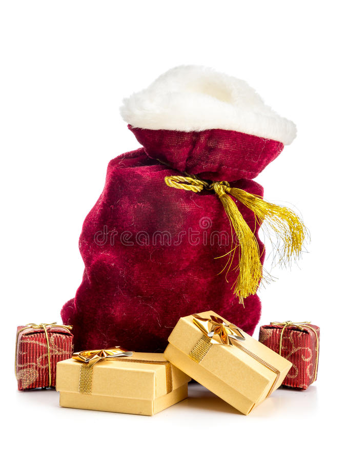 Santa's sack. Santa Claus bag full of christmas presents over white background stock images
