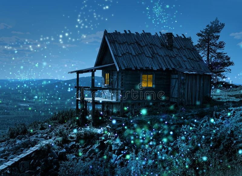 Santa`s secret cottage with magic lights. Santa Claus secret cottage on Lapland fell top surrounded by magic light spots royalty free stock photo