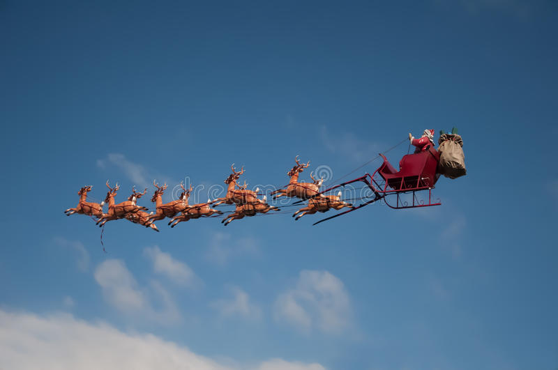Santa's Sleigh. Flying above the city during Christmas stock photo