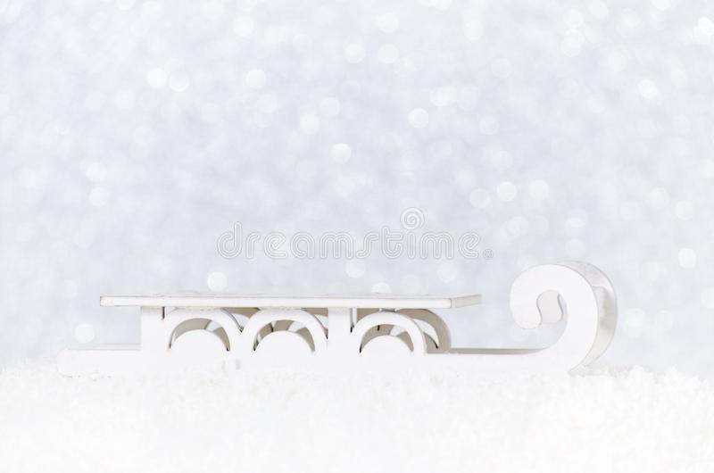 Santa`s sleigh in snow on white christmas background with bokeh. Selective focus stock photography