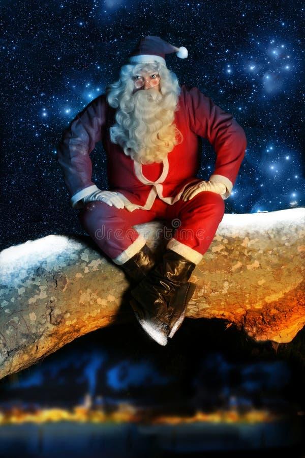 Santa and Snow at night royalty free stock photos