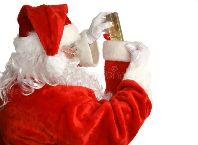 Santa Stuffs Stocking stock image