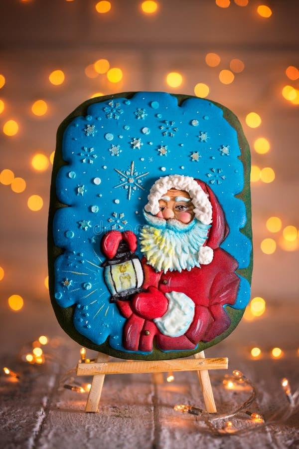 Santa sur le pain d'épice images stock