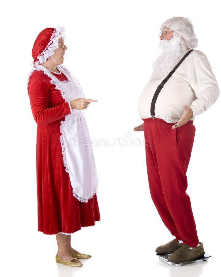 Santa sur les échelles photo libre de droits