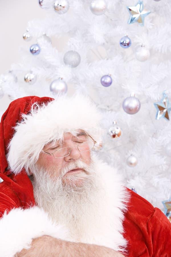 Santa taking a nap royalty free stock photos