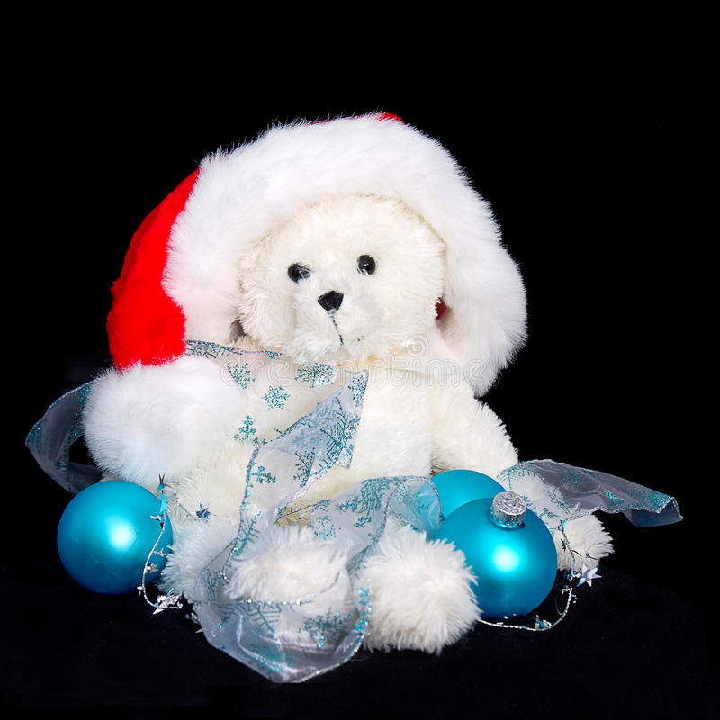 Santa Teddy Bear - blaue Dekorationen stockfotos