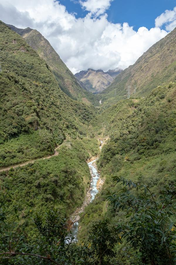 The Santa Teresa River in green lush valley of Andes mountains, Peru. Landscape of peruvian mountains with Santa Teresa River in green lush valley, The royalty free stock image