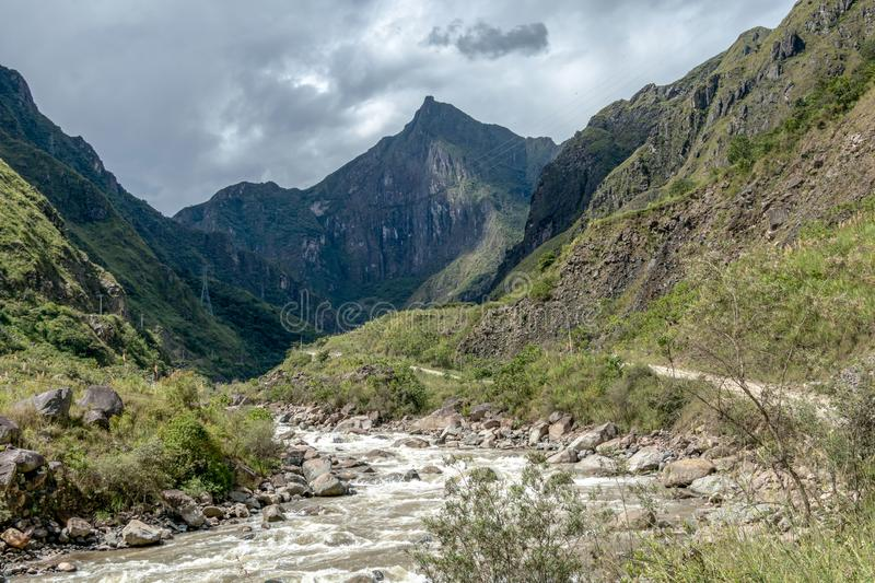 The Santa Teresa River in green lush valley. Hiking trail to Machu Picchu, Peru. Landscape of peruvian mountains with Santa Teresa River in green lush valley stock photo
