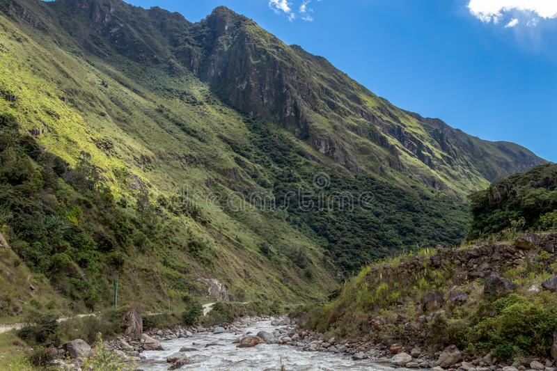 The Santa Teresa River in green lush valley. Hiking trail to Machu Picchu, Peru. Landscape of peruvian mountains with Santa Teresa River in green lush valley stock images