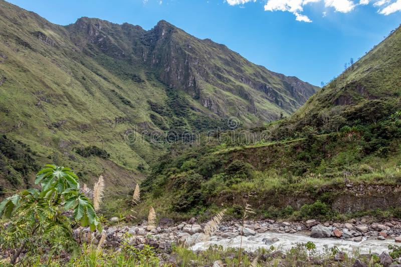 The Santa Teresa River in green lush valley. Hiking trail to Machu Picchu, Peru. Landscape of peruvian mountains with Santa Teresa River in green lush valley stock photos