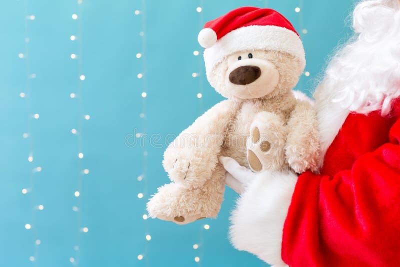 Santa trzyma misia zdjęcia stock