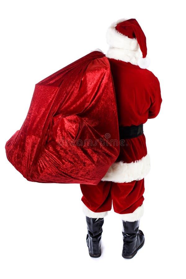 Santa: Tylni widok Santa mienia prezenta worek zdjęcie royalty free