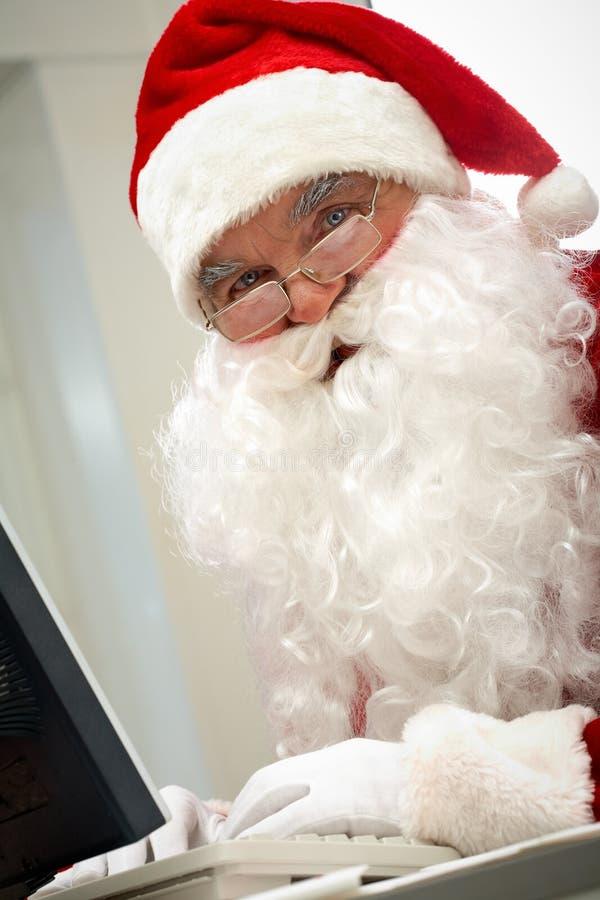 Download Santa typing stock image. Image of december, merry, looking - 24738991