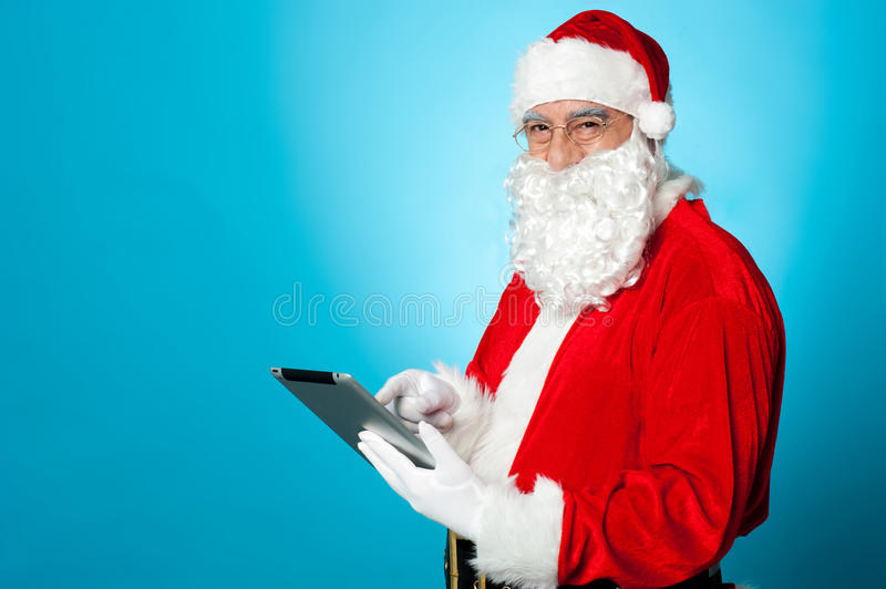 Download Santa Using Newly Launched Electronic Tablet Stock Image - Image: 27837103