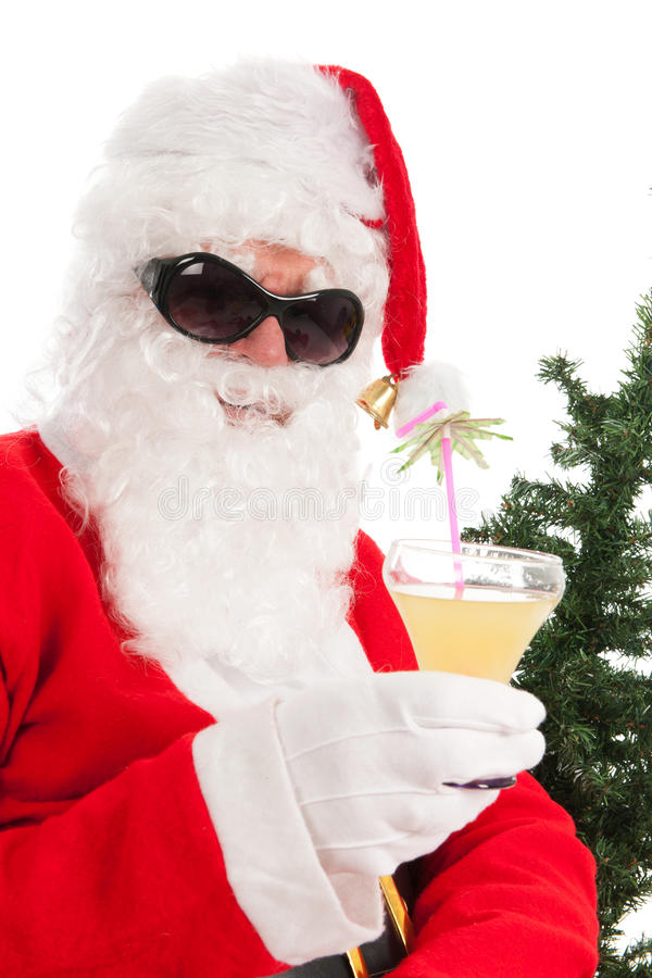 Santa on vacation. With sunglasses and cocktail royalty free stock photo