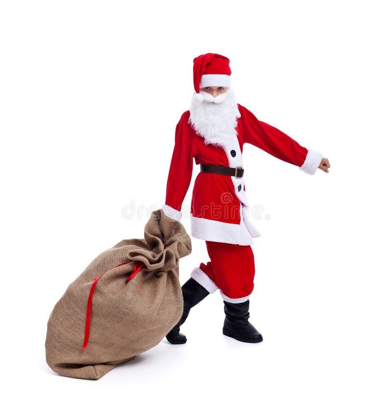 Santa vi che porta i regali di Natale fotografie stock libere da diritti