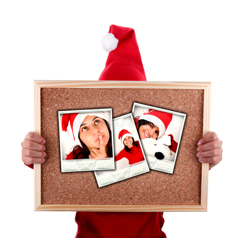 Santa woman holding christmas photos stock photography
