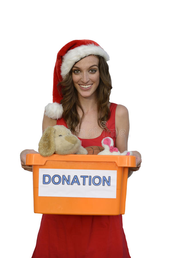 Santa woman holding christmas toy donation box royalty free stock photography