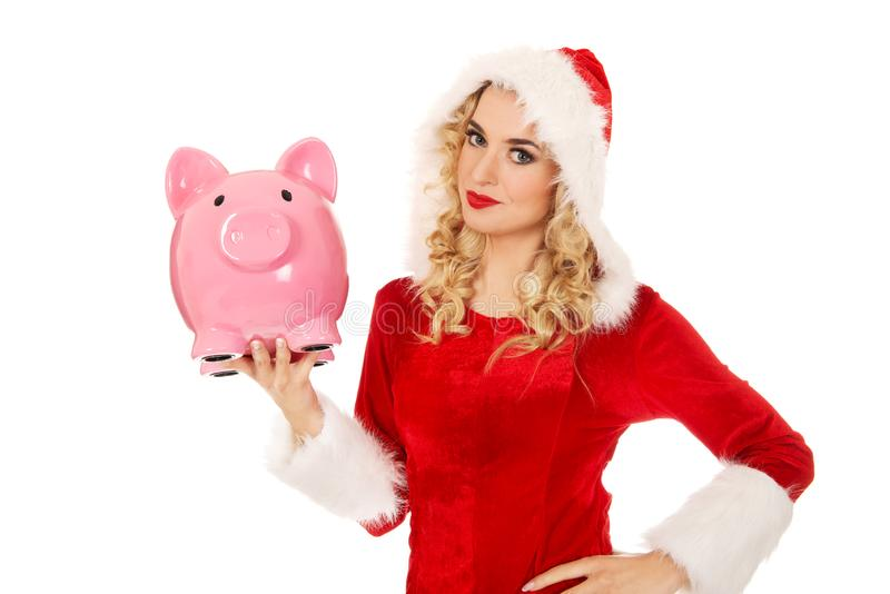 Santa woman holding a piggy bank stock photos