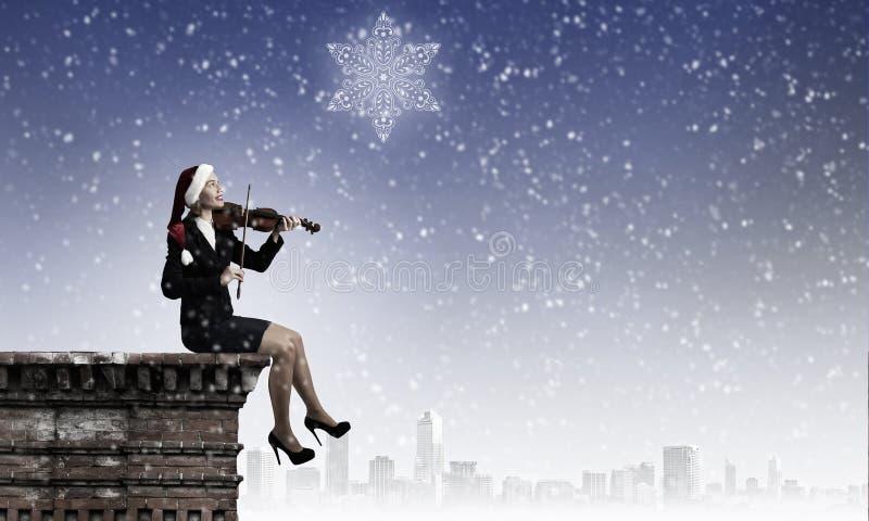 Santa woman play violin stock images