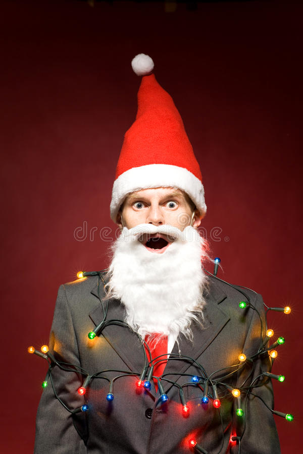 Download Santa Wrapped In Christmas Lights Stock Photo - Image: 17894688